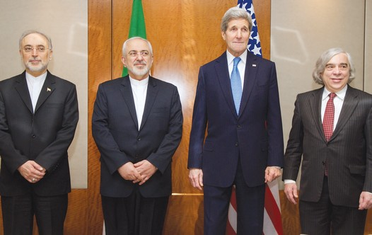 US AND IRANIAN negotiators pose yesterday in Geneva before a discussion of Iran's nuclear program