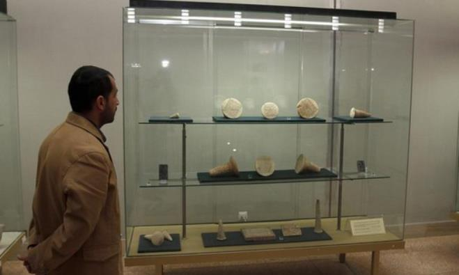 A man looks at artifacts displayed inside the Iraqi National Museum in Baghdad