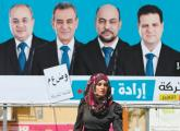 A WOMAN walks past a campaign billboard for the Joint (Arab) List in Umm el-Fahm yesterday