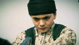The young boy who appears in the ISIS video moments before purportedly executing