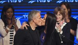 Yesh Atid leader Yair Lapid and his wife Lihi kiss at a women