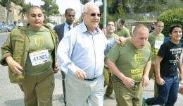 PRESIDENT REUVEN RIVLIN runs a stretch of the Jerusalem Marathon with special-needs kids