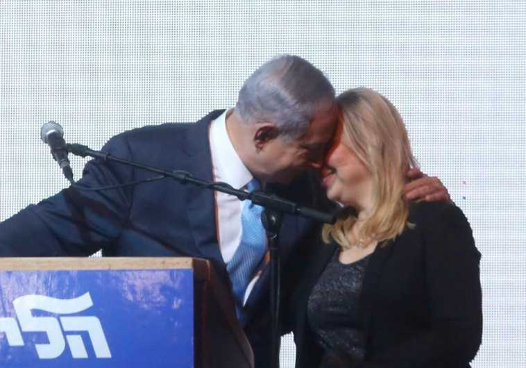 Prime Minister Benjamin Netanyahu (L) shares a moment with his wife, Sara, at Likud headquarters