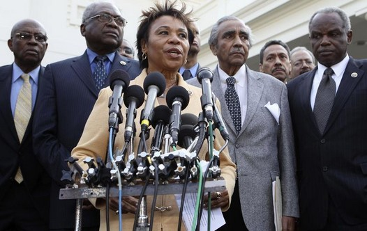 Members of the Congressional Black Caucus, led by Chair Representative Barbara Lee (C)