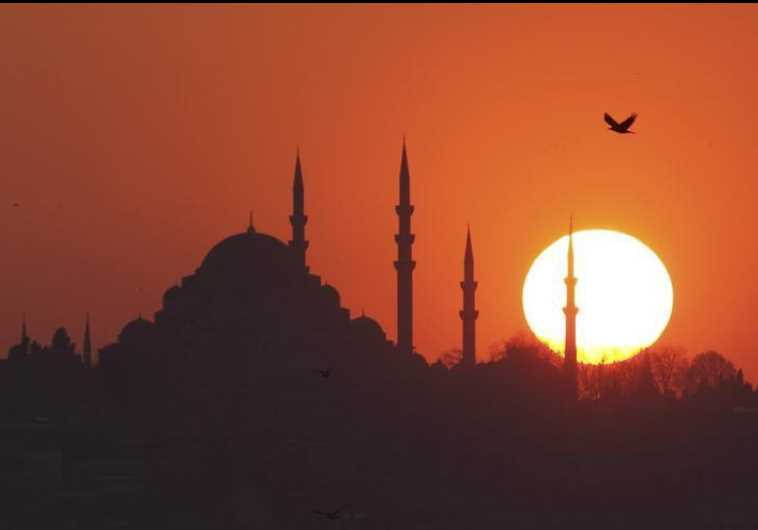 The sun sets over the Ottoman-era Suleymaniye mosque in Istanbul
