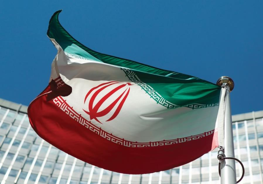AN IRANIAN flag flutters in the breeze