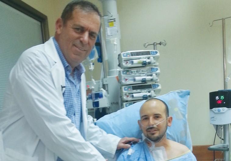 PROF. DAN ARAVOT visits his patient, Ran Azulai