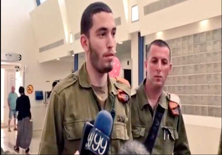 St.-Sgt. Tomer Lan, who was stabbed in the back by a Palestinian attacker, shot the terrorist dead