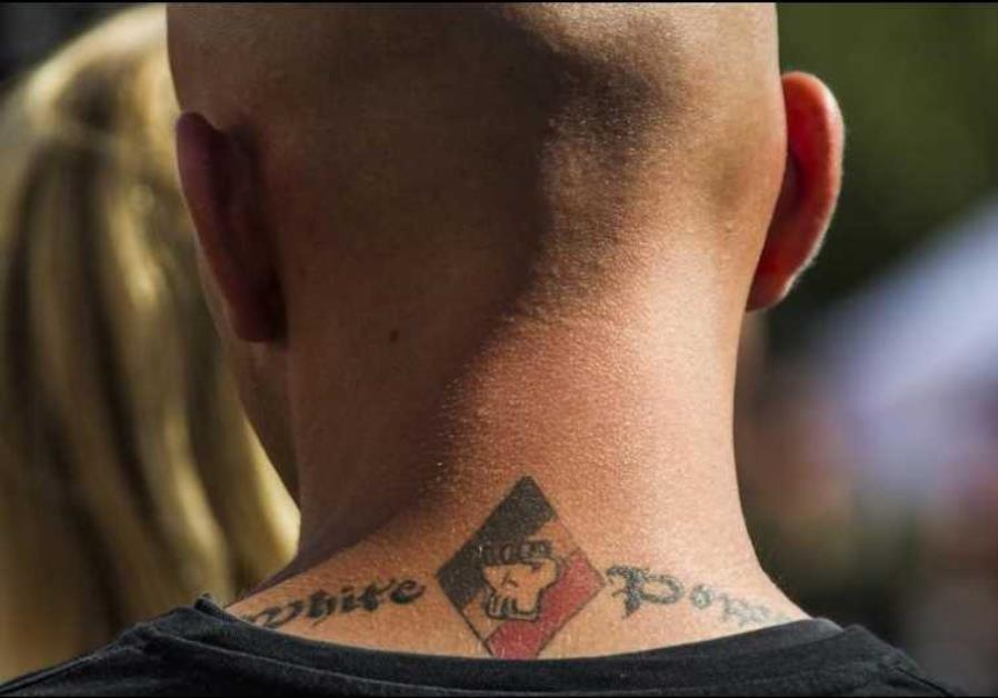 A white power tattoo is seen at a far-right wing summer festival in the German village of Viereck