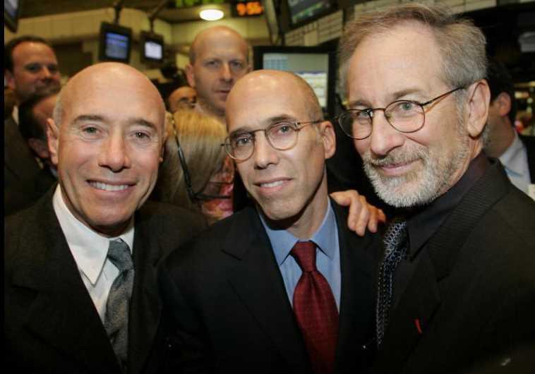 David Geffen (L), Jeffrey Katzenberg (C), and Steven Spielberg (R), pose at New York Stock Exchange
