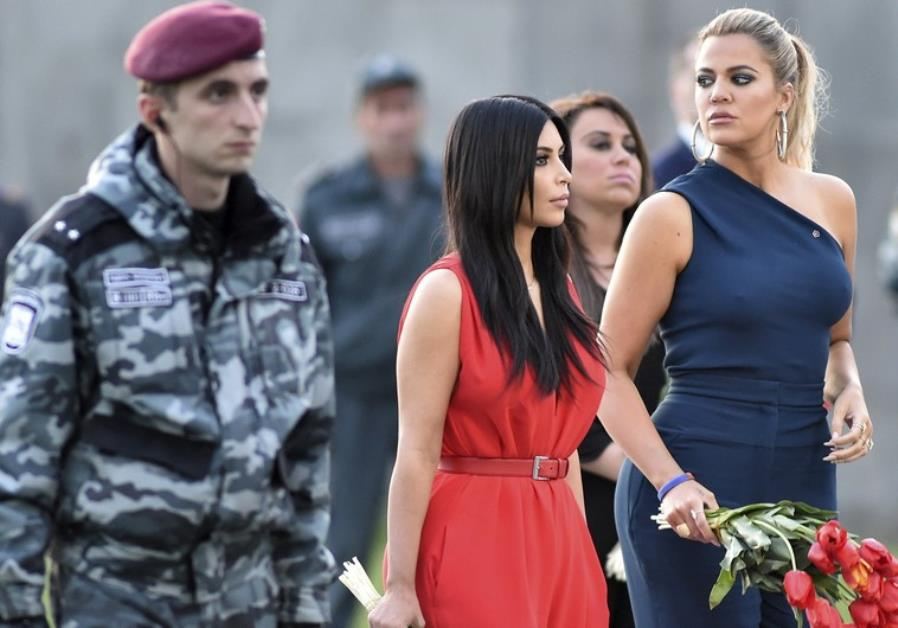 kardashian sisters lay flowers at the armenian genocide memorial in