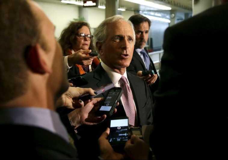 Senate Foreign Relations Committee Chairman Senator Bob Corker (R-TN) (C) talks to reporters