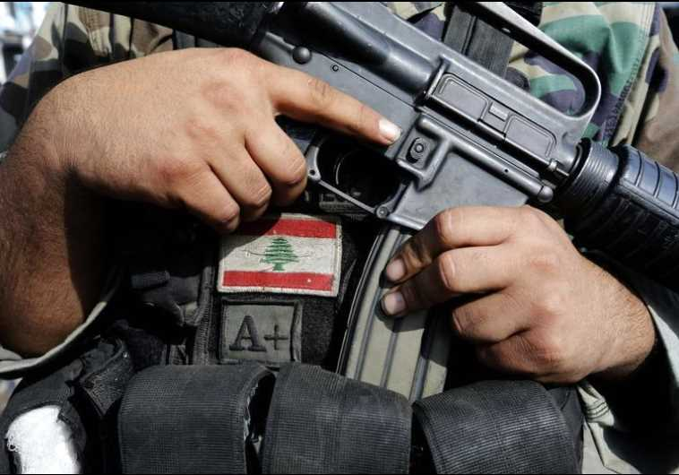 A Lebanese army soldier holds his weapon
