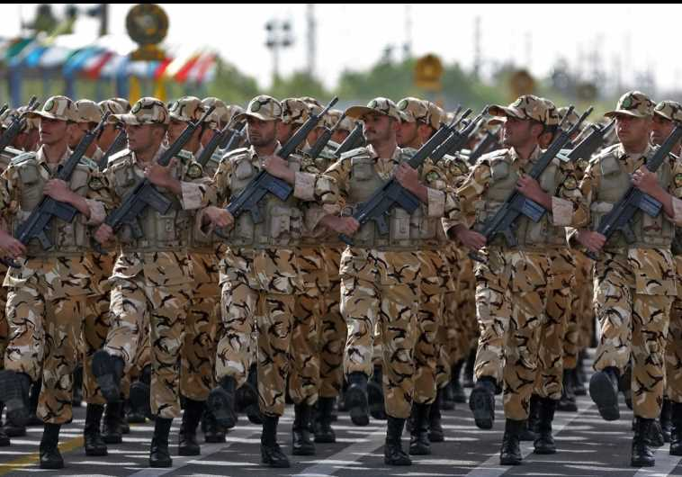 Iranian soldiers take part in a military procession in Tehran