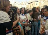Women of the Wall carry a Torah scroll into the women's section of the Western Wall plaza