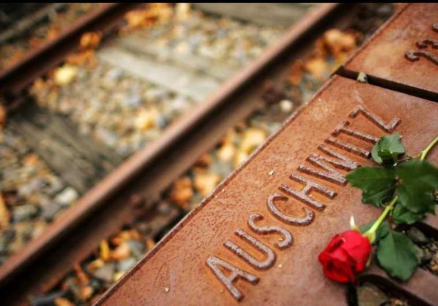 A red rose lies at Gleis 17 (platform 17) holocaust memorial in Berlin