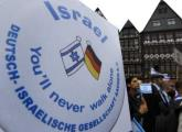 Protesters attend a rally against anti-Semitism in Frankfurt