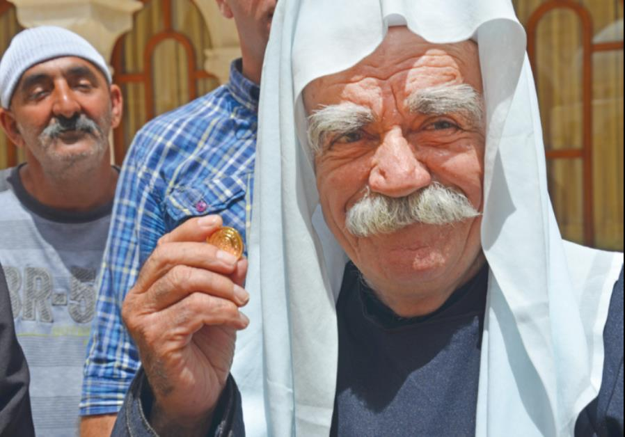 DRUSE SPIRITUAL LEADER Sheikh Muafek Tarif attends the ceremony honoring the divers on Monday.