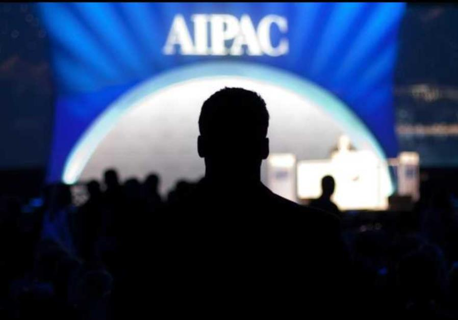 A man waits for the start of the evening's speeches at the American Israel Public Affairs Committee