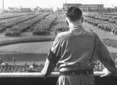 German chancellor Adolf Hitler looks out at a rally staged by the Nazi Party