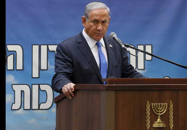 Prime Minister Benjamin Netanyahu speaks during a Memorial Day ceremony on Mount Herzl military ceme