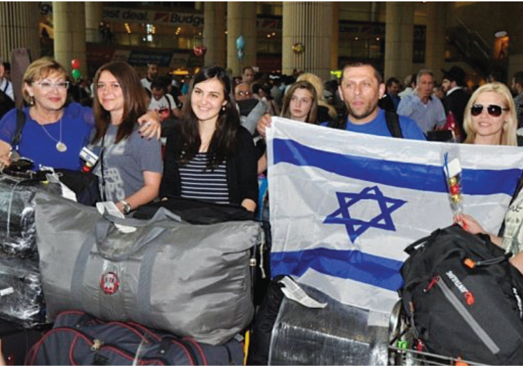 JEWISH IMMIGRANTS from Ukraine arrive at Ben-Gurion Airport in 2012.