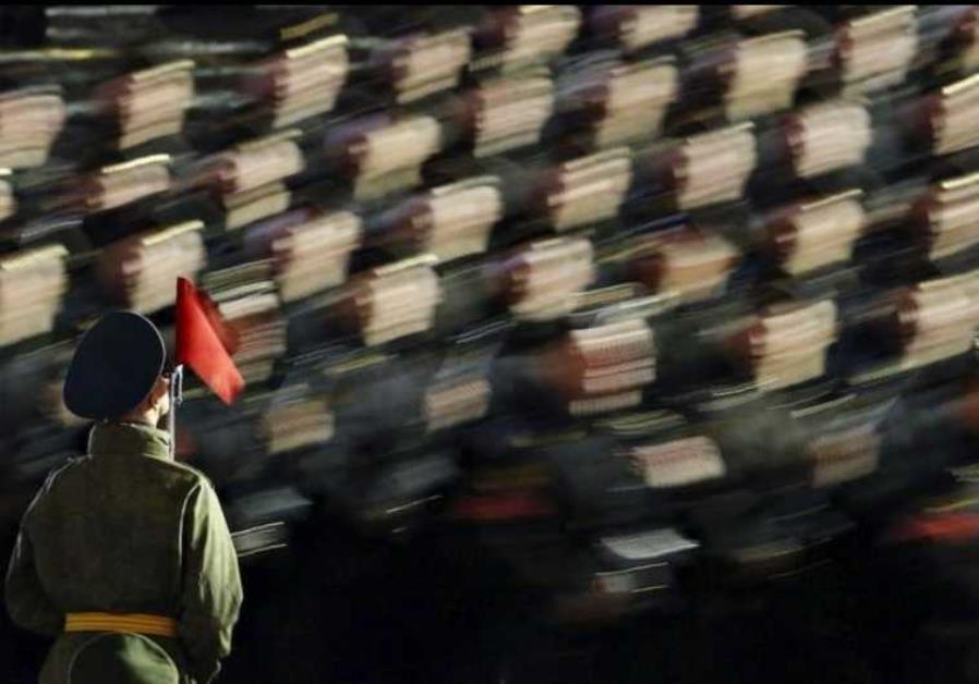 Russian servicemen take part in a rehearsal for the Victory parade on Moscow's Red Square