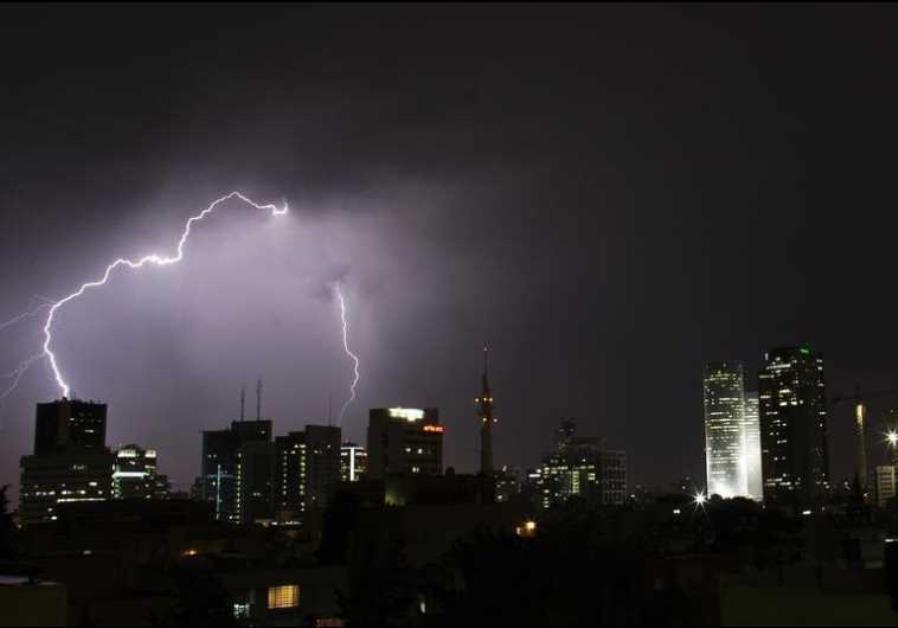 Lightning strikes over the skyline of Tel Aviv during a rain storm