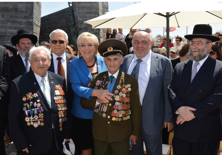 NETANYA MAYOR Miriam Feirberg Ikar stands with World War II Jewish veterans at a ceremony to mark 70