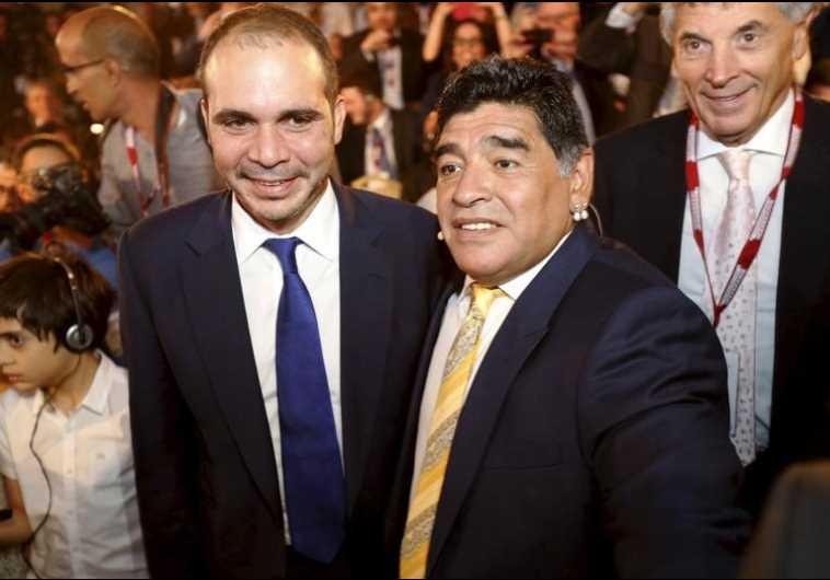 Jordan's Prince Ali Bin Al Hussein (L), FIFA presidential candidate, poses with Diego Maradona
