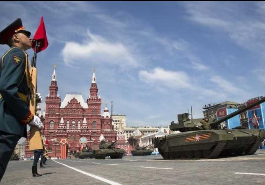 New Russian T-14 Armata tank drives during the Victory Day parade at Red Square in Moscow