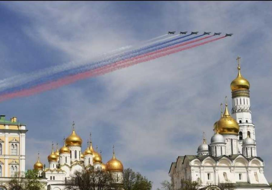 Russian Sukhoi Su-25 Frogfoot ground-attack planes fly in formation over the Red Square