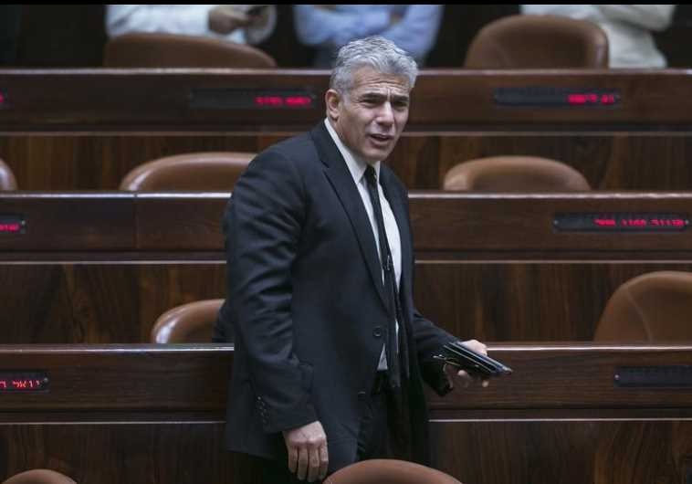 Israel's dismissed Finance Minister Yair Lapid arrives at the Knesset