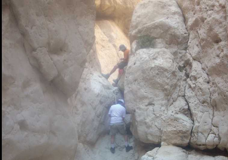 'STEADILY WE began our climb, following a passage through the rocky pathway'