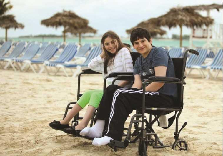 TZVI AND RACHELI Herzfeld enjoy a day at the beach