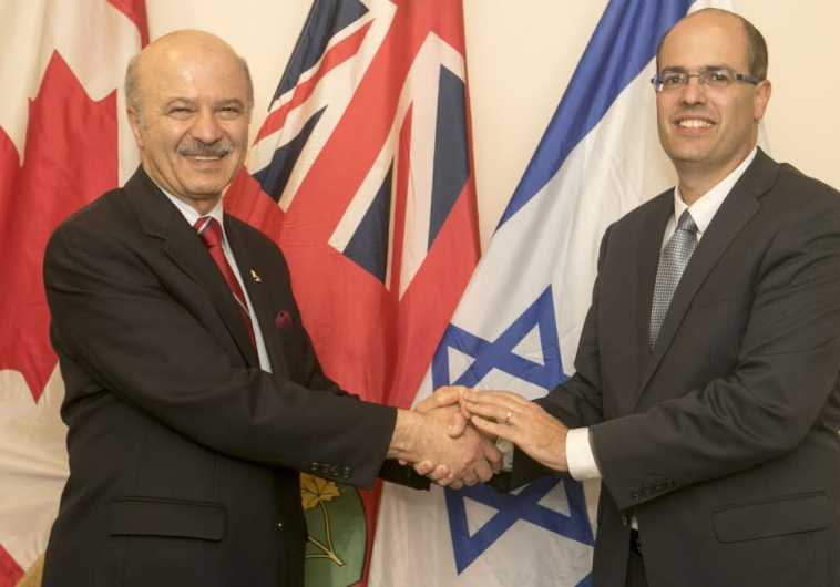 Ontario's Minister of Research and Innovation Reza Moridi, Left, shakes hands with Chief Scientist A