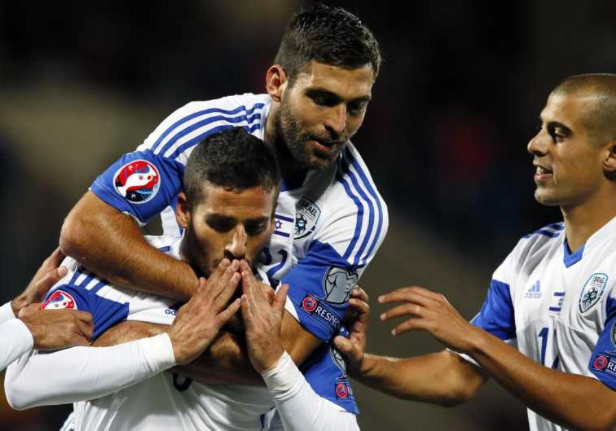 Israel's Tomer Hemed (L), Itay Shechter (C) and Tal Ben Chaim celebrate a goal against Andorra