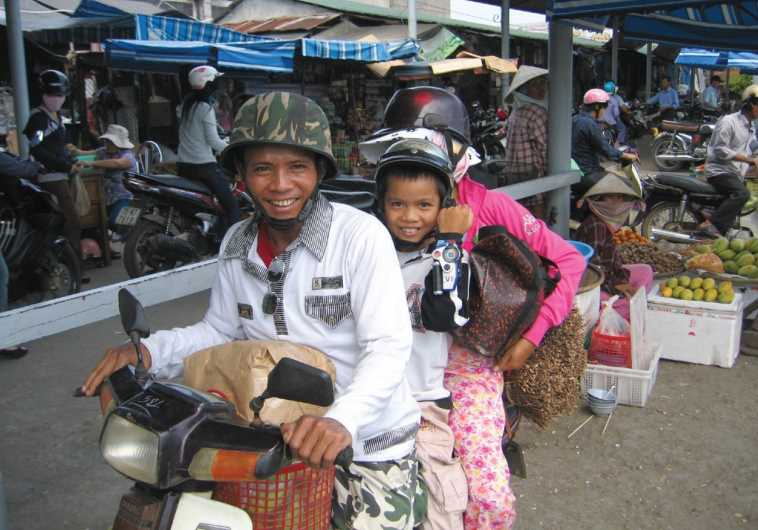 A VIETNAMESE family on a motorbike in Hanoi