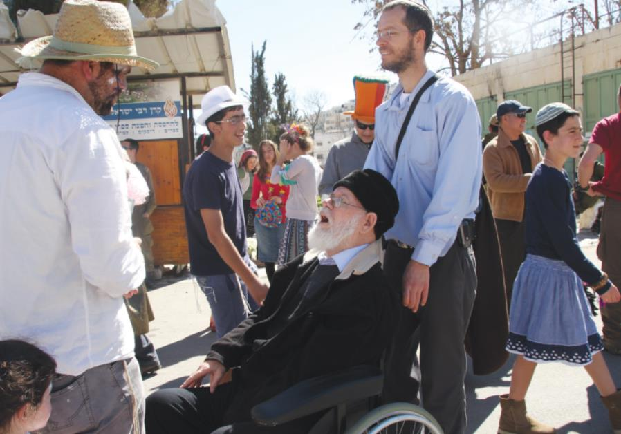 RABBI MOSHE LEVINGER (center) and his son Shlomo tour Hebron for Purim in March.