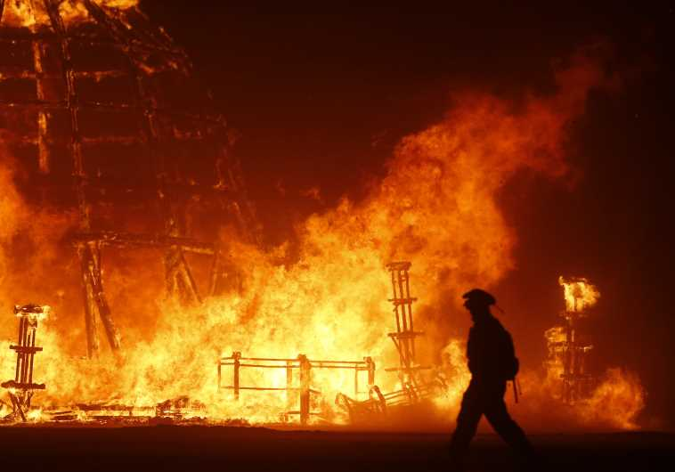 The Temple of Grace burns on the last day of the Burning Man 2014 festival