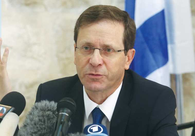 Zionist Union head Isaac Herzog speaks to the press