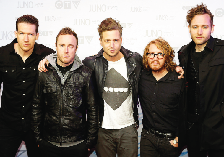 ONE REPUBLIC appears on a red carpet in Canada last year