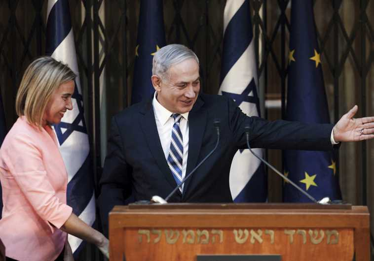 Prime Minister Benjamin Netanyahu (R) shows the way to EUnion foreign policy head Federica Mogherini