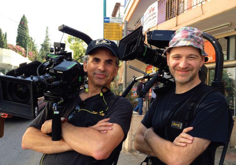 ROGER SHERMAN (left) and Anthony Savini film nearby Ma'alot Tarshiha.