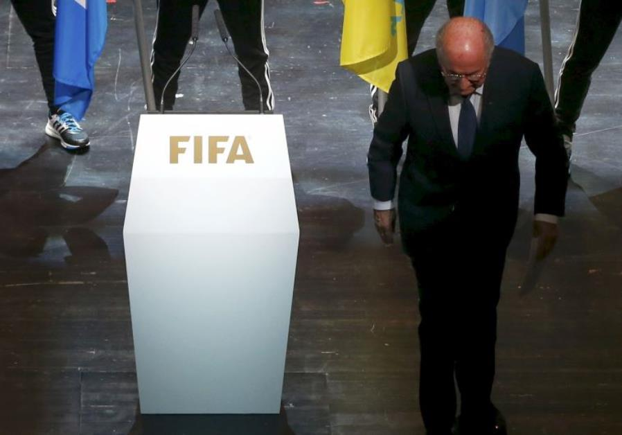 FIFA President Sepp Blatter leaves the stage after making a speech