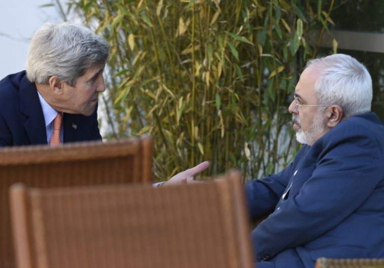 US Secretary of State John Kerry (L) talks with Iranian Foreign Minister Mohammad Javad Zarif