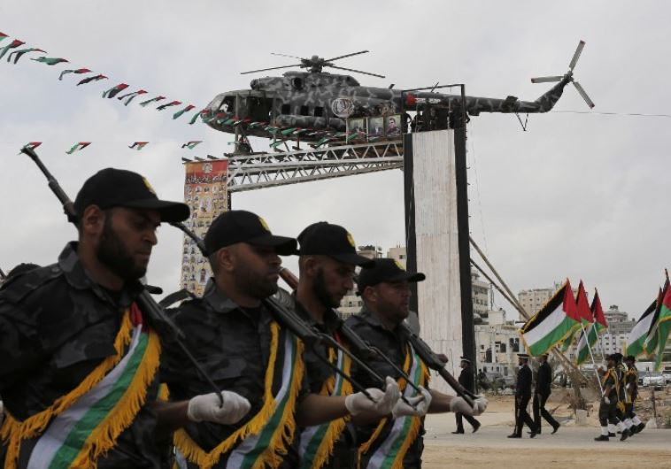 Hamas security forces march during a military review