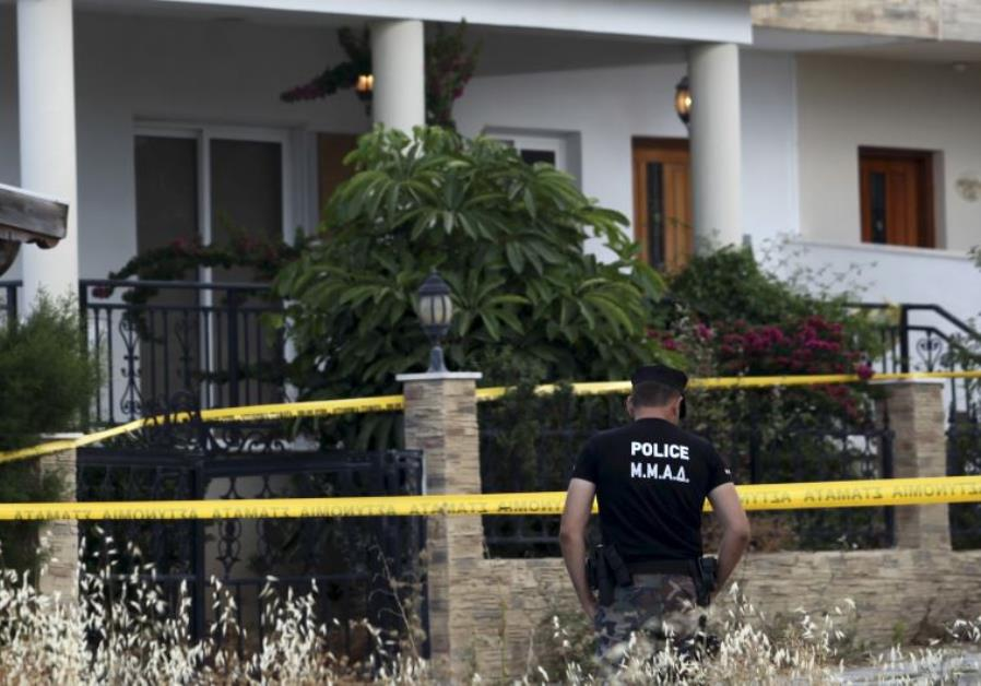 A policeman stands guard at a house where police discovered almost two tons of ammonium nitrate