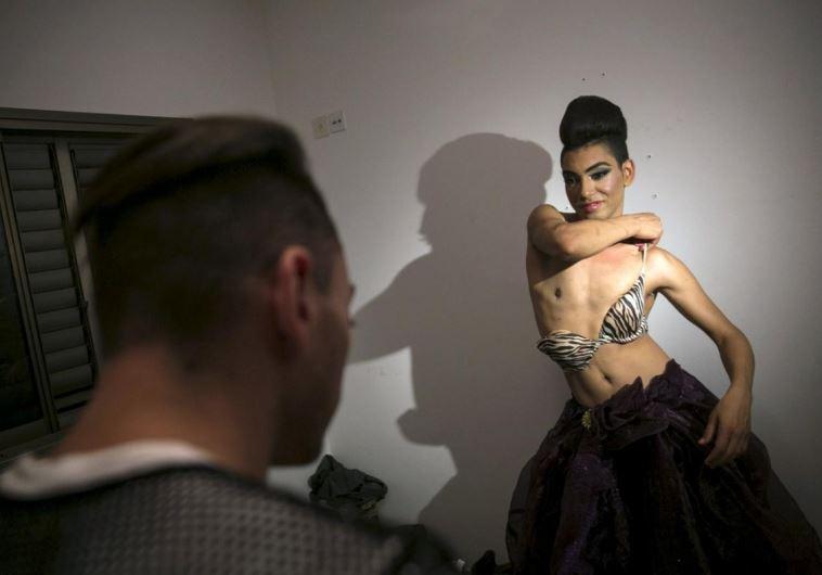Karam Dadu, a transvestite homosexual Israeli Arab, prepares before a drag show in Tel Aviv
