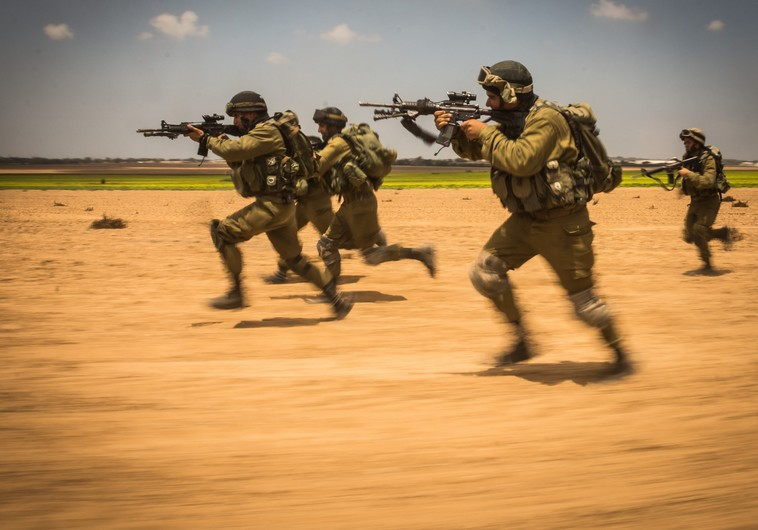 IDF soldiers storm a target during the ground incursion into Gaza